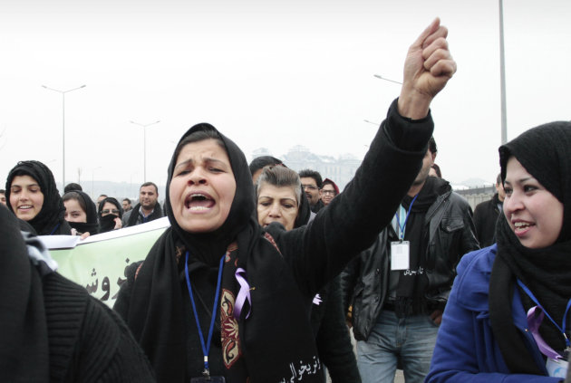 An Afghan woman shouts during a march calling for the end of violence against women, in Kabul, Afghanistan, Thursday, Feb. 14, 2013. Dozens of Afghan activists have marked Valentine's Day by marching