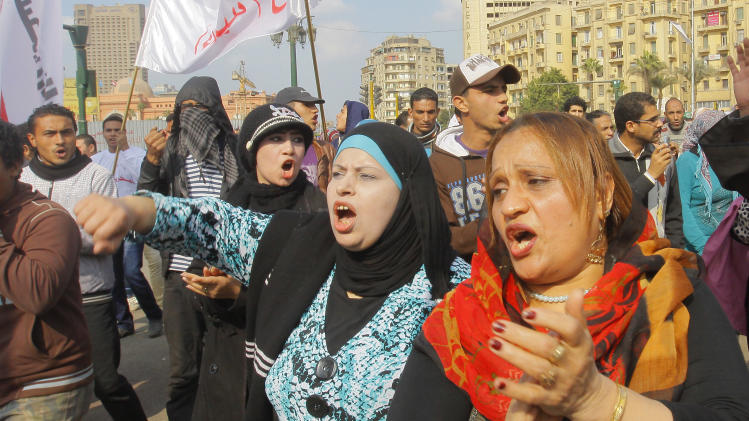 Egyptian women shout anti-Mohammed Morsi slogans during a protest in Tahrir Square, the focal point of Egyptian uprising, in Cairo, Egypt, Saturday, Dec. 29, 2012. Egypt's Islamist president warned Saturday against any unrest that could harm the drive to repair the country's battered economy in a sharply worded speech that urged the opposition to work with his government. Mohammed Morsi made the comments in his first speech to the newly convened upper house of parliament, which he said will have full legislative powers until a new lower house of parliament is elected next year.(AP Photo/Amr Nabil)