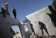Palestinians hold the Qatari flag near the Rafah border crossing with Egypt prior to the arrival of Qatari Emir Sheikh Hamad bin Khalifa al-Thani. Qatar's emir called for Palestinian unity as he made a landmark visit to the Gaza Strip on Tuesday, the first to the enclave by a head of state since Hamas took over in 2007