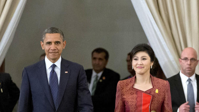 U.S. President Barack Obama, left, and Thai Prime Minister Yingluck Shinawatra arrive for a joint news conference at the  Government House in Bangkok, Thailand, Sunday, Nov. 18, 2012. (AP Photo/Carolyn Kaster)