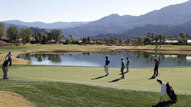 Jeff Maggert, left, hits on the 18th green of the Nicklaus Private Course at PGA West during the first round of the Humana Challenge golf tournament, Thursday, Jan. 17, 2013, in La Quinta, Calif. (AP Photo/Ben Margot)