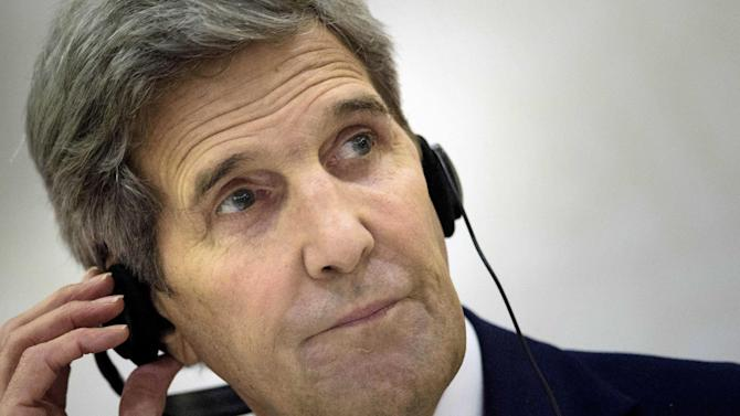 U.S. Secretary of State John Kerry listens to an interpreter during a press conference following a meeting with foreign ministers of the Gulf Cooperation Council (GCC) on Monday, Aug. 3, 2015 in Doha. Qatari Foreign Minister Khaled al-Attiyah on Monday backed the deal on Iran's nuclear program as the best available option, after talks in Doha with US Secretary of State John Kerry. (Brendan Smialowski/pool photo via AP)