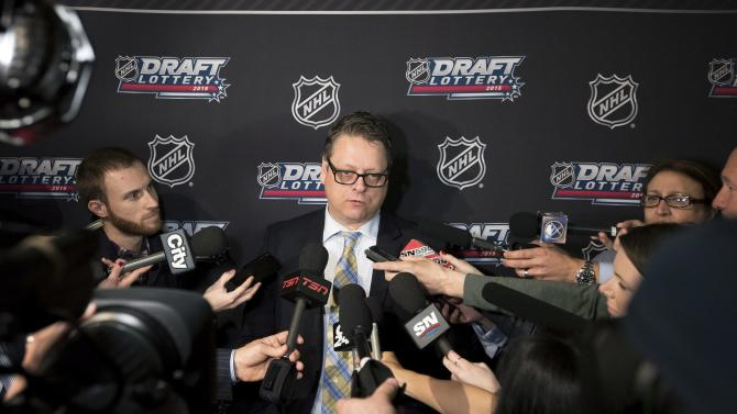 Buffalo Sabres general manager Tim Murray speaks to reporters after the NHL draft lottery, Saturday, April 18, 2015, in Toronto. (Darren Calabrese/The Canadian Press via AP)