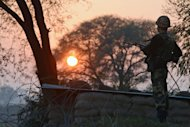 An Indian Border Security Force soldier keeps watch at an outpost along the India-Pakistan border in Abdulian, 38 kms southwest of Jammu, on January 9, 2013. India delivered a dressing-down Wednesday to Islamabad's envoy to Delhi as it accused Pakistan's army of beheading one of two soldiers killed in Kashmir, but both sides warned against inflaming tensions