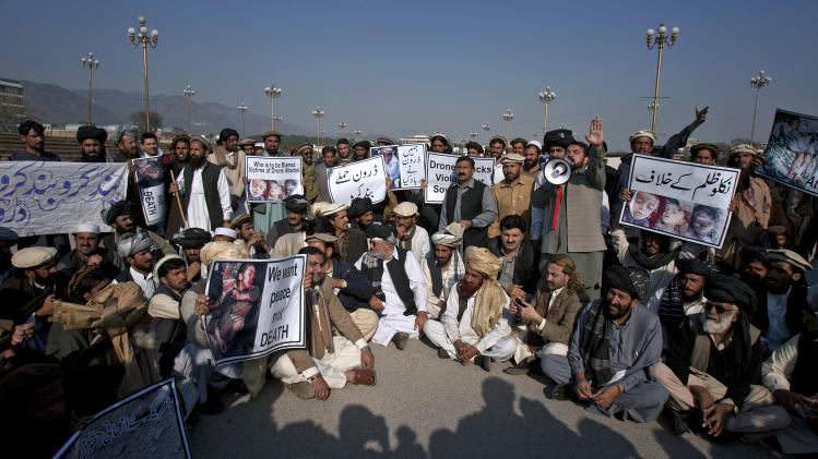 Pakistani tribal villagers affected by U.S. drone attacks hold a rally near parliament house in Islamabad, Pakistan on Saturday, Feb, 25, 2012. Dozens of tribal villagers form Waziristan region rallied in the capital Islamabad against drone attacks in Pakistani tribal areas. (AP Photo/Anjum Naveed)