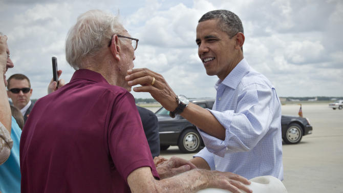 President Barack Obama shakes hands as he arrives at the Richmond International Airport in Richmond, Va., Saturday, July 14, 2012. (AP Photo/J. Scott Applewhite)