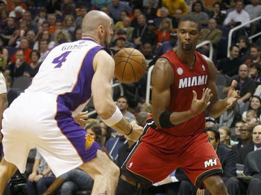 Ailing James, Heat end long trip by beating Suns