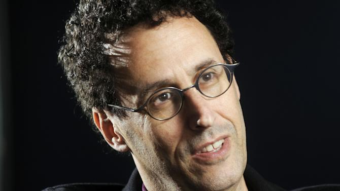 """FILE - In this April 30, 2009 photo, Tony Kushner is shown during a break from rehearsal of his new play at the Guthrie Theatre in Minneapolis, Minn.,  Kushner won a Pulitzer Prize for """"Angels in America,"""" his epic play about the AIDS epidemic, and is a New York literary fixture who has received more than a dozen honorary degrees from American colleges and universities.  So it was a shock when the Board of Trustees of the City University of New York voted last month to withhold a promised honorary degree after a trustee said the playwright was anti-Israel. CUNY later backtracked under a barrage of criticism, and Kushner will accept his degree on Friday, June 2, 2011. (AP Photo/Craig Lassig)"""