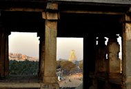 "The Virupaksha temple is one of the most recognized structures in Hampi. Located at the Hampi Bazaar, it has an iconic 160-foot tall 'gopuram' or tower at its entrance. This temple is dedicated to Lord Shiva. Though the city was destroyed in 1565, worship in the temple has persisted over the centuries.<br><br>Photographer, traveler and wildlife enthusiast RADHA RANGARAJAN loves to wander, camera in tow. An aesthete, her forte is creative and offbeat compositions. Radha has presented her images in many forums and publications. Faces intrigue her and she loves to tell stories through her photographs. Birds, butterflies, leaves and shafts of light fuel her imagination. Besides nature and wildlife photography, she enjoys traveling and making images of people and places. <a target=""_blank"" href=""http://radha-rangarajan.blogspot.com/"">Enjoy more of her work at her blog</a><br>"