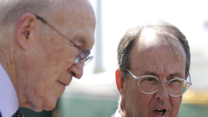 FILE - The co-chairmen of the president's deficit reduction commission, Erskine Bowles, right, and Alan Simpson talk to reporters outside the White House in Washington, in this April 14, 2011 file photo after their meeting with President Barack Obama in the Oval Office. The $2.3 trillion less that Washington will be borrowing over the next decade takes the government much of the way toward the $4 trillion, 10-year goal set by Obama and the co-chairmen of his deficit commission, former Republican Sen. Alan Simpson and former Democratic White House staff chief Erskine Bowles. (AP Photo/Carolyn Kaster, File)