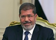 Amid growing anti-US protests, Egypt's new Islamist President Mohamed Morsi, pictured in July 2012, is walking a delicate tightrope, keen not to be seen as too pro-American by his people while keeping billions of dollars flowing from the West, analysts say