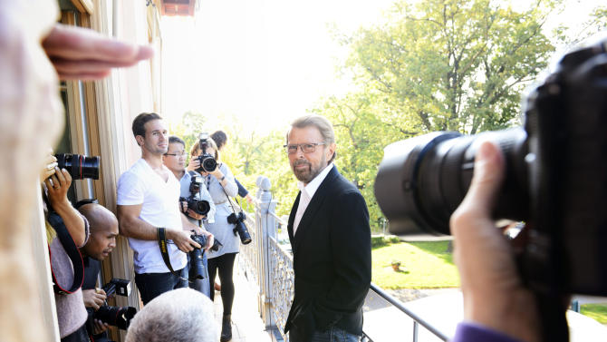 """Former ABBA band member Bjoern Ulvaeus, centre, arrives for a news conference, at the ABBA museum construction site in Stockholm., Sweden, Wednesday Oct. 3, 2012. A traveling ABBA exhibit is to get a permanent home in a new museum dedicated mostly to the Swedish quartet that has sold nearly 400 million records since its heyday in the 1970s. Former band member Bjoern Ulvaeus said Wednesday that """"ABBA The Museum"""" will be part of a Swedish music hall of fame to be inaugurated in Stockholm next spring. (AP Photo/Henrik Montgomery) SWEDEN OUT"""