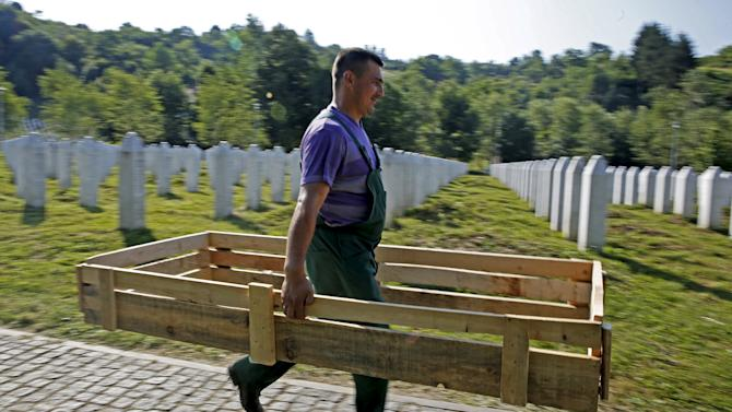 Worker walks at a memorial centre for Srebrenica Massacre victims in Potocari