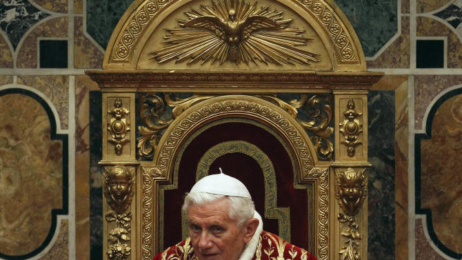 "Pope Benedict XVI listens to speeches during an audience with foreign ambassadors to the Holy See, at the Vatican, Monday, Jan. 7, 2013. The pontiff urged diplomats to supply urgent aid to Syria to relieve civilian suffering, while expressing hope that Jerusalem would become ""a city of peace and not of division."" (AP Photo/Giampiero Sposito, Pool)"