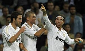 Real Madrid's Higuain and Pepe congratulate Ramos after scoring against Olympique Lyon during their Champions League soccer match in Madrid
