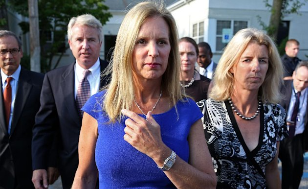 Kerry Kennedy, ex-wife of New York Gov. Andrew Cuomo, flanked by her brother Christopher Kennedy, second left, and sister Rory Kennedy, right, walks from the North Castle Justice Court in Armonk, N.Y.