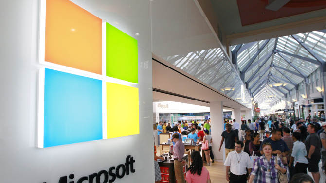 FILE - In this Thursday, Aug. 23, 2012 file photo, the Microsoft Corp. logo, left, is seen on an exterior wall of a new Microsoft store inside the Prudential Center mall, in Boston. Microsoft will use its annual developers conference to release a preview of Windows 8.1, a free update that promises to address some of the gripes people have with the latest version of the company's flagship operating system. The Build conference, which starts Wednesday, June 26, 2013, in San Francisco, will give Microsoft's partners and other technology developers a chance to try out the new system before it becomes available to the general public later in the year. (AP Photo/Steven Senne, File)