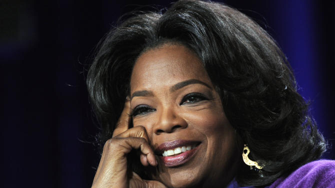 """FILE - In this Jan. 6, 2011 file photo, Oprah Winfrey listens to a reporter's question during the Discovery Communications Television Critics Association winter media tour in Pasadena, Calif.  """"The Oprah Winfrey Show"""" is ending its run May 25, 2011, after 25 years, and millions of her fans around the globe are waiting to see how she will close out a show that spawned a media empire. (AP Photo/Chris Pizzello, File)"""