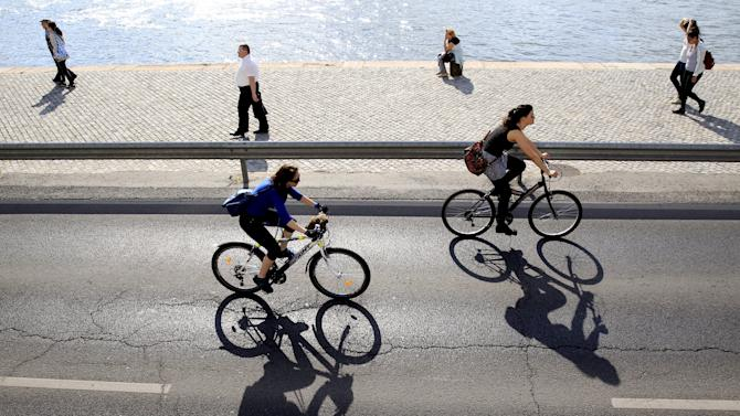 Cyclists ride around the Hungarian capital Budapest