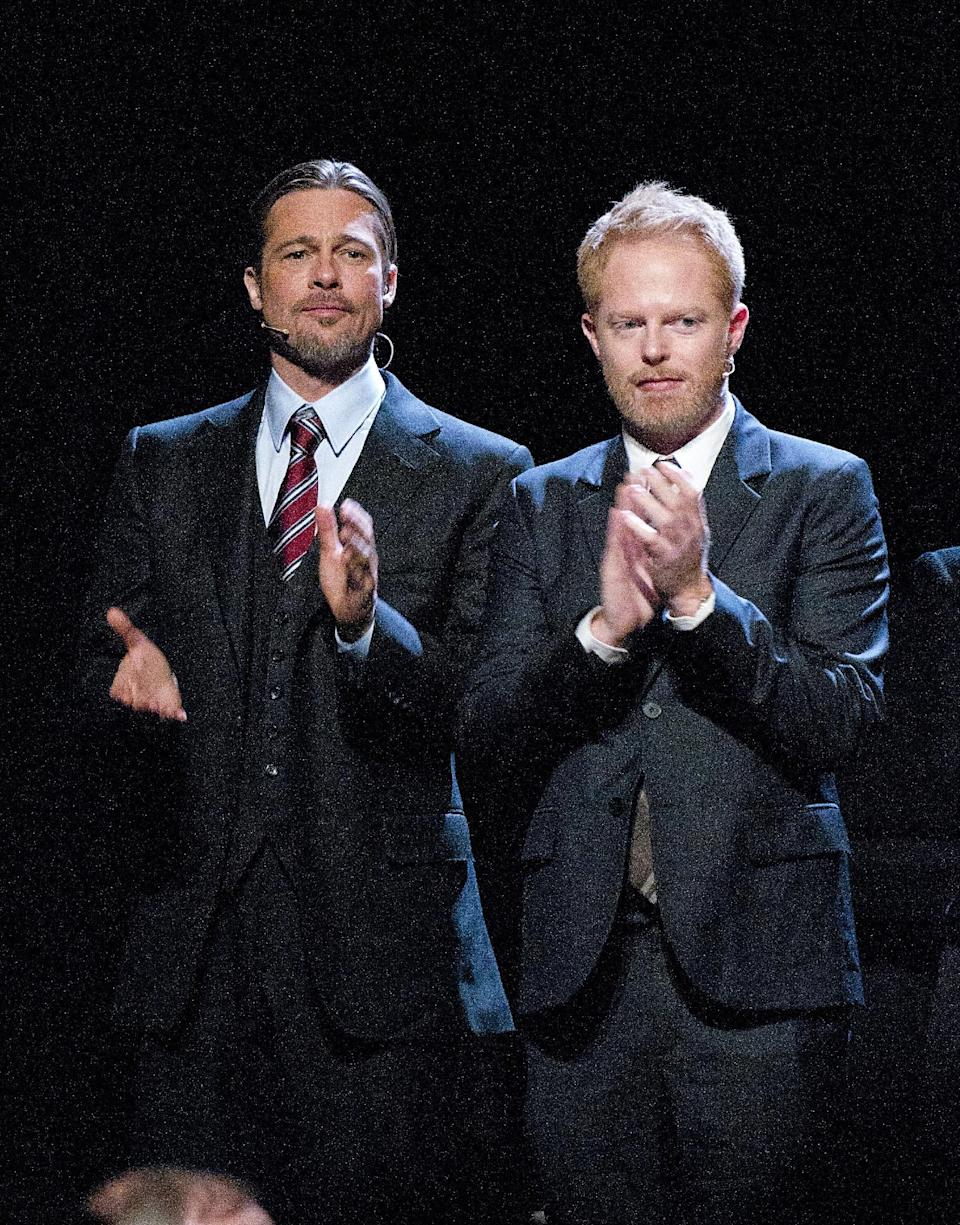 "Actor Brad Pitt, left, and actor Jesse Tyler Ferguson clap during the curtain call at the Los Angeles premiere of the play ""8"" in Los Angeles on Saturday, March 3, 2012. (AP Photo/Dan Steinberg)"
