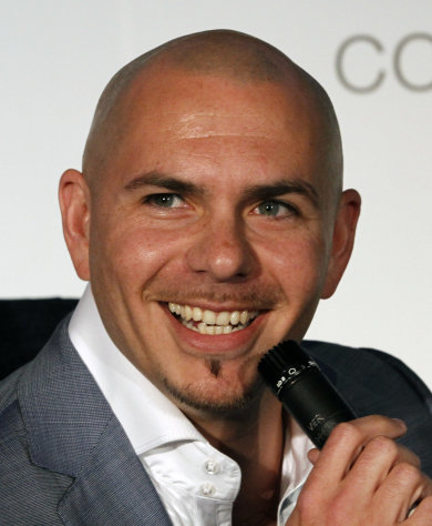 Miami rapper Pitbull smiles during an interview in Miami, Wednesday, April 25, 2012. (AP Photo/Alan Diaz)