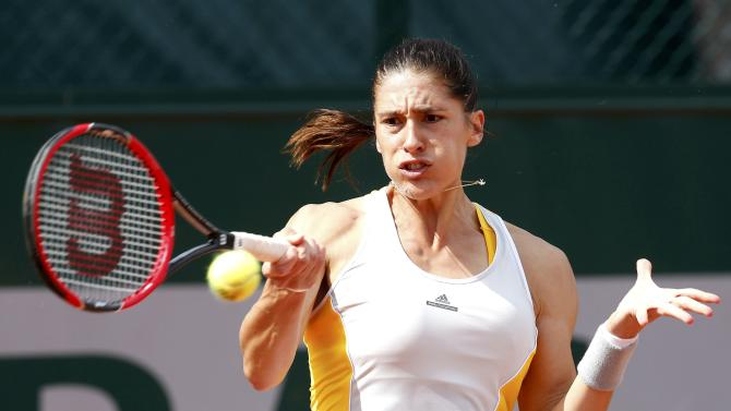 Andrea Petkovic of Germany plays a shot to Lourdes Dominguez Lino of Spain during their women's singles match at the French Open tennis tournament at the Roland Garros stadium in Paris
