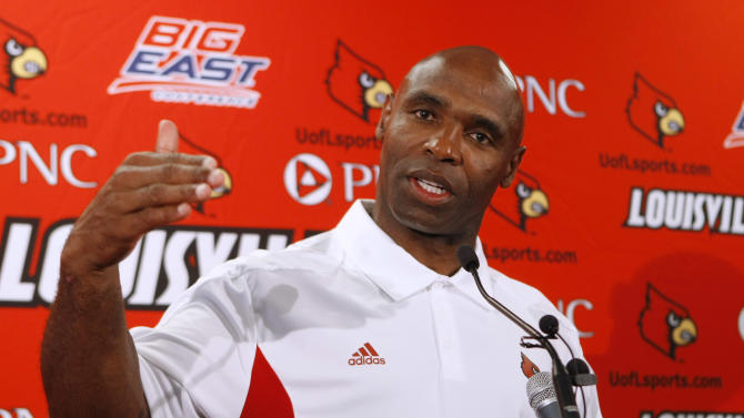 FILE - This Aug. 10, 2011 file photo shows Louisville football coach Charlie Strong gesturing as he speaks at a news conference in Louisville, Ky. A person familiar with the situation says that the Atlantic Coast Conference's presidents and chancellors have voted unanimously to add Louisville as the replacement for Maryland.  The person says ACC leaders also considered Connecticut and Cincinnati over the past week before choosing to add the Cardinals from the Big East.  The person spoke to The Associated Press Wednesday morning, Nov. 28, 2012 on condition of anonymity because the ACC has not publicly discussed future expansion plans. (AP Photo/Ed Reinke, File)