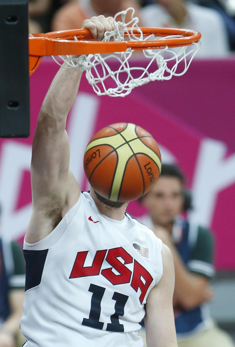USA's Kevin Love dunks during the first half of a preliminary men's basketball game against France at the 2012 Summer Olympics, Sunday, July 29, 2012, in London. (AP Photo/Jae C. Hong)