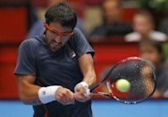Serbia&#39;s Janko Tipsarevic serves to Slovenia&#39;s Aljaz Bedene during their quarter final match as part of the Vienna ATP 250 tournament. Tipsarevic, still jet-lagged from playing in Shanghai last week, enjoyed a swift 6-2, 4-2 passage to the semi-finals of the ATP Austrian Open after Bedene quit with a thigh injury