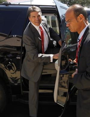 Republican presidential candidate Texas Gov. Rick Perry arrives for a Republican presidential debate at the Reagan Library Wednesday, Sept. 7, 2011, in Simi Valley, Calif.  (AP Photo/Chris Carlson)
