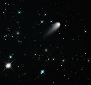 Comet ISON Blazes with Distant Galaxies in Stunning Hubble Photo