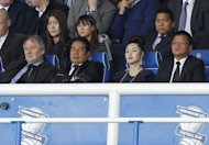 File photo of Birmingham City owner Carson Yeung (2nd L) watches the team play at St. Andrews in Birmingham. Yeung took control of Birmingham City in October 2009 in an 81 million ($130 million) takeover from David Sullivan and David Gold, now the co-owners of West Ham