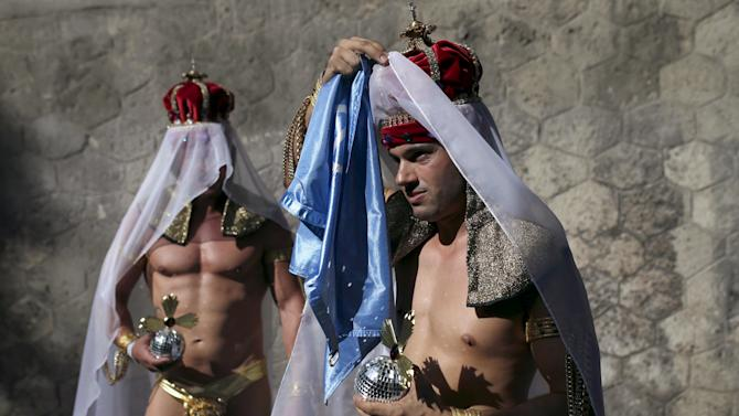Revellers head to the gay pride parade in Madrid