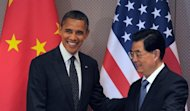 US President Barack Obama and his Chinese counterpart Hu Jintao arrive for a bilateral meeting on the sidelines of the 2012 Seoul Nuclear Security Summit