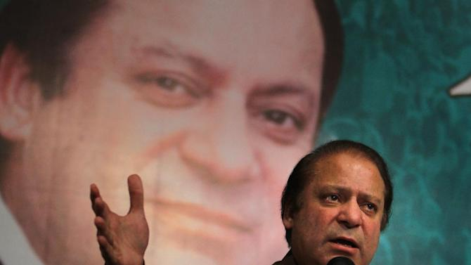 """Pakistan's former Prime Minister Nawaz Sharif addresses party workers in Lahore, Pakistan on Monday, May 20, 2013. Pakistan's presumptive prime minister called for peace talks with Taliban militants at war with the government Monday, potentially charting a course that could put him at odds with the country's powerful army. Sharif said terrorism was one of the most serious problems plaguing the country and any offer by the Pakistani Taliban to talk """"should be taken seriously."""" (AP Photo/K.M. Chaudary)"""