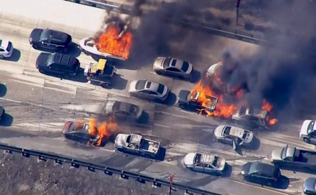 Cars are shown burning on the Interstate 15 freeway in the Cajon Pass, California in the frame grab from KNBC video July 17, 2015.  A brush fire burni...