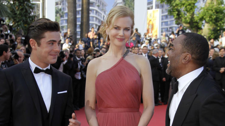 From left, actors Zac Efron, Nicole Kidman, and director Lee Daniels arrive for the screening of The Paperboy at the 65th international film festival, in Cannes, southern France, Thursday, May 24, 2012. (AP Photo/Francois Mori)