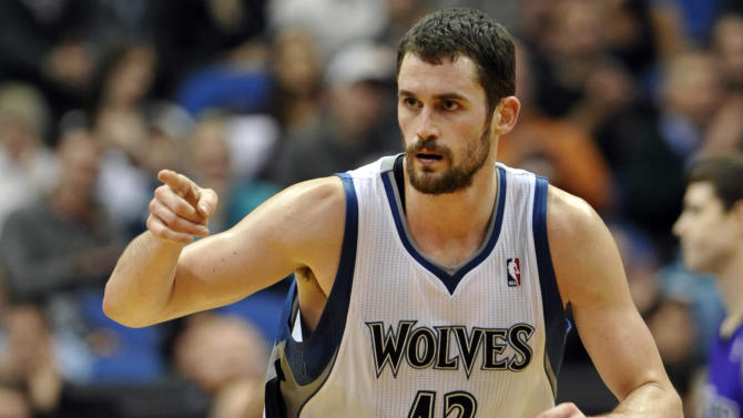 FILE - In this Jan. 16, 2012, file photo, Minnesota Timberwolves' Kevin Love reacts during  the second half of an NBA basketball game against the Sacramento Kings in Minneapolis. Love will miss the next six to eight weeks after breaking his right hand in a workout on Wednesday, Oct. 17, 2012. (AP Photo/ Jim Mone, File)