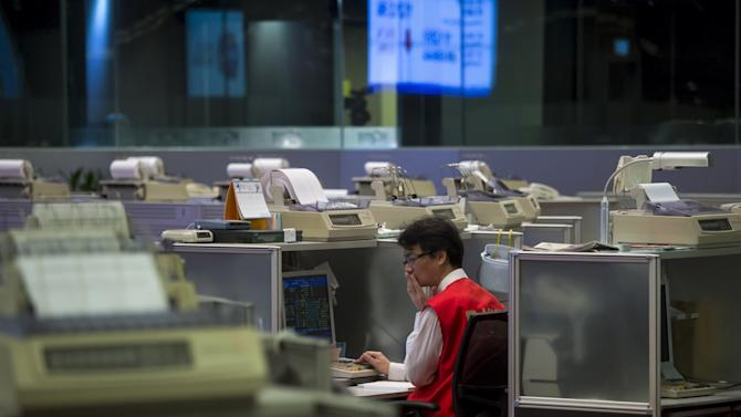 A floor trader reacts inside the trading hall at the Hong Kong Exchanges in Hong Kong, China