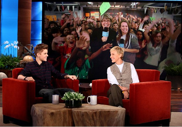 "Justin Bieber and Ellen DeGeneres check in via live shot with Whitney Elementary School in Las Vegas, NV.  Justin announces he will perform a concert at the school in December as seen on ""The Ellen De"