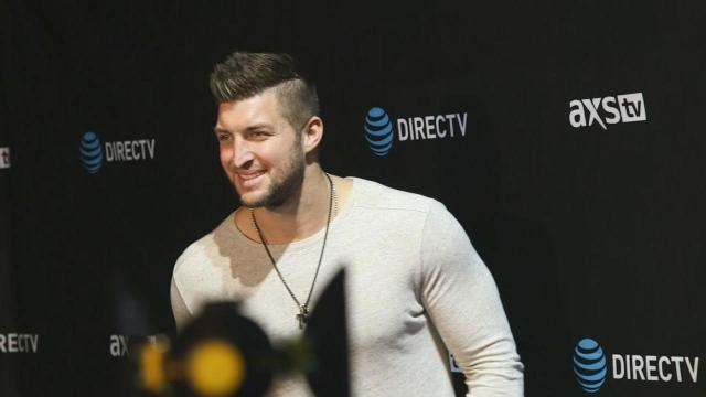 Former Bronco Tim Tebow Rooting for Cam Newton in Super Bowl 50