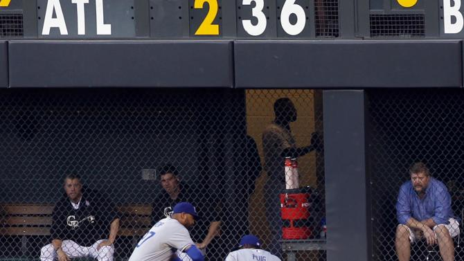 Los Angeles Dodgers right fielder Yasiel Puig (66) is checked by center fielder Matt Kemp after being injured when making a catch against the Colorado Rockies in the fifth inning of a baseball game in Denver, Wednesday, July 3, 2013. Puig remained through the fifth inning but was then pulled. (AP Photo/David Zalubowski)