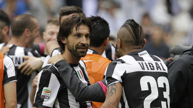 Juventus midfielder Arturo Vidal, of Chile,  and his teammate Juventus midfielder Andrea Pirlo celebrate at the end of a Serie A soccer match between Juventus and Palermo, at the Juventus stadium, in Turin, Italy, Sunday, May 5, 2013. Juventus edged Palermo 1 - 0 to win its second consecutive title. (AP Photo/Luca Bruno)