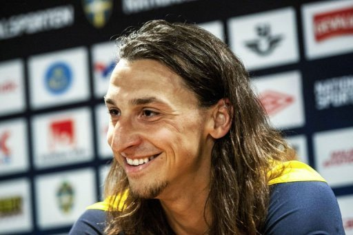Swedish national soccer player Zlatan Ibrahimovic smiles during a press conference