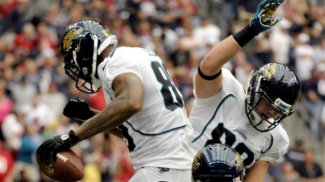 Jacksonville Jaguars' Marcedes Lewis, left, Zach Potter, right, and Will Ta'ufo'ou (45) celebrate a touchdown against the Houston Texans during the third quarter of an NFL football game, Sunday, Nov. 18, 2012, in Houston. (AP Photo/Dave Einsel)