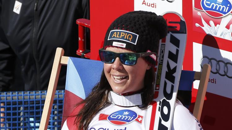 Aufdenblatten of Switzerland rests after her career's last race in the women's downhill event during the FIS Alpine Skiing World Cup finals in the Swiss ski resort of Lenzerheide