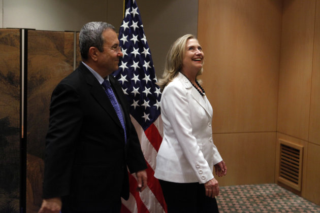Israeli Defense Minister Ehud Barak, left, and US Secretary of State Hillary Clinton pose for photographers before their meeting Monday, July 16, 2012 in Jerusalem, Israel. (AP Photo/Lior Mizrahi, Pool)