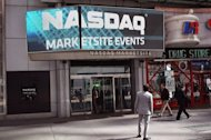 Pedestrians walk past the Nasdaq stock market at Times Square in New York City in March 2012. Facebook has picked the technology-heavy NASDAQ exchange for a much-anticipated stock market debut expected next month, according to unconfirmed reports Thursday