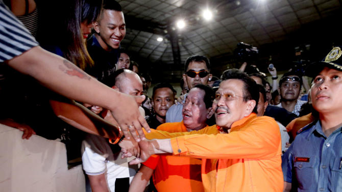 "Former Philippine President and now Mayor-elect Joseph ""Erap"" Estrada is congratulated by supporters shortly after his proclamation by the City Board of Canvassers of the Commission Elections Tuesday May 14, 2013, a day after the country's automated midterm elections in Manila, Philippines.  Former President Estrada was proclaimed Tuesday as the new mayor of the Philippine capital, his first elected post since he was ousted in an anti-corruption revolt 12 years ago. (AP Photo/Bullit Marquez)"