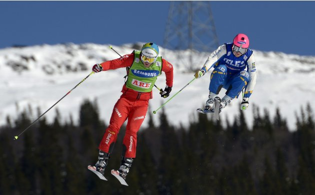 Switzerland's Fiva competes during the FIS Freestyle Skiing World Cup men's SkiCross in Are, next to Norberg of Sweden